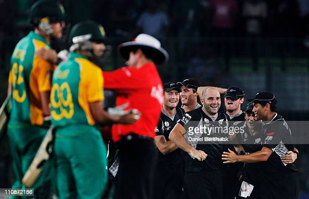 Luke Woodcock of New Zealand celebrates with team mates after taking the wicket of Morne Morkel of South Africa to win the game during the 2011 ICC...