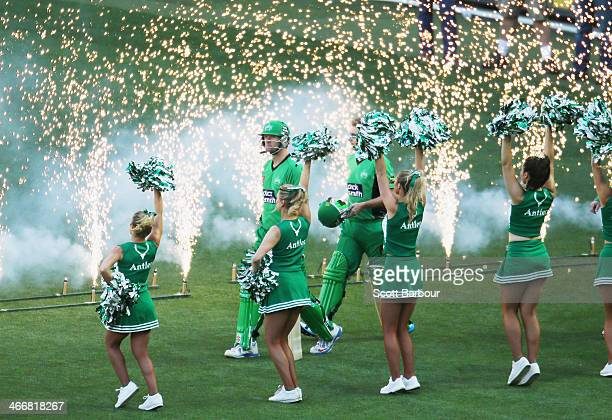 Luke Wright and Cameron White of the Stars walk out to bat past the Stars cheerleaders during the Big Bash League Semi Final match between the...