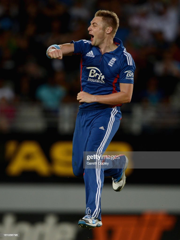 Luke Wright of England celebrates dismissing Martin Guptill of New Zealand during the 1st T20 International between New Zealand and England at Eden Park on February 9, 2013 in Auckland, New Zealand.