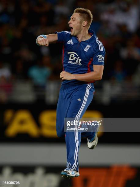 Luke Wright of England celebrates dismissing Martin Guptill of New Zealand during the 1st T20 International between New Zealand and England at Eden...