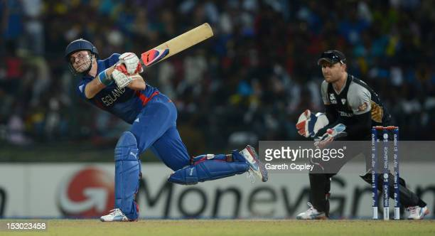 Luke Wright of England hits out for six runs watched by New Zealand wicketkeeper Brendon McCullum during the ICC World Twenty20 2012 Super Eights...