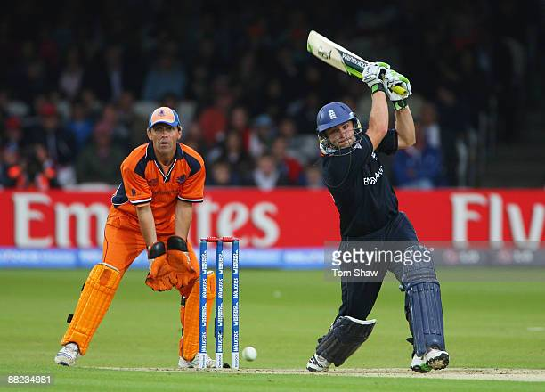 Luke Wright of England hits out watched by Jeroen Smits of Netherlands during the ICC World Twenty20 Group B match between England and the...