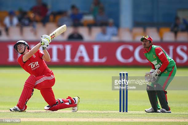 Luke Wright of England Lions hits a six over long on as wicketkeeper Anamal Haque of Bangladesh A looks on during the One Day International match...