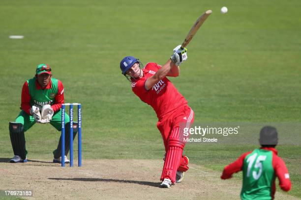 Luke Wright of England Lions hits a straight six off the bowling of Ziaur Rahman of Bangladesh A during the One Day International match between...
