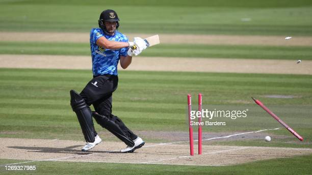 Luke Wright of Sussex Sharks is bowled out by Gus Atkinson of Surrey during the Vitality T20 Blast match between Sussex Sharks and Surrey at The 1st...