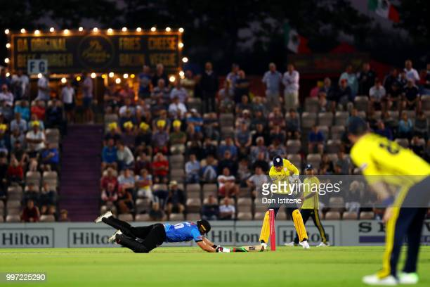 Luke Wright of Sussex slides in to the crease during the Vitality Blast match between Hampshire and Sussex Sharks at The Ageas Bowl on July 12 2018...