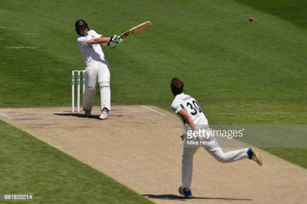 Luke Wright of Sussex smashes a six off the bowling of Ed Barnard of Worcestershire during the Specsavers County Championship Division Two match...