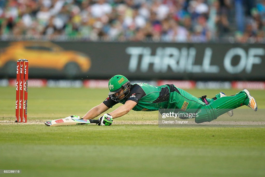 Luke Wright of the Melbourne Stars dives to avoid a run out during the Big Bash League match between the Melbourne Stars and the Sydney Sixers at Melbourne Cricket Ground on January 21, 2017 in Melbourne, Australia.