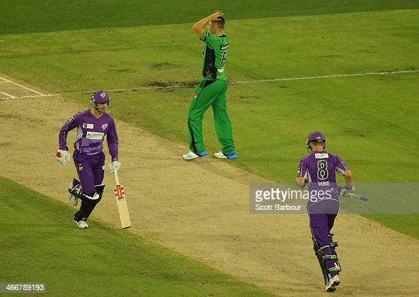 Luke Wright of the Stars looks on as George Bailey and Tim Paine of the Hurricanes run between the wickets during the Big Bash League Semi Final...