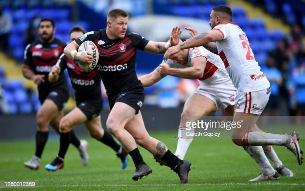 Luke Yates of Salford gets past Elliott Minchella of Hull KR during the Betfred Super League match between Hull Kingston Rovers and Salford Red...