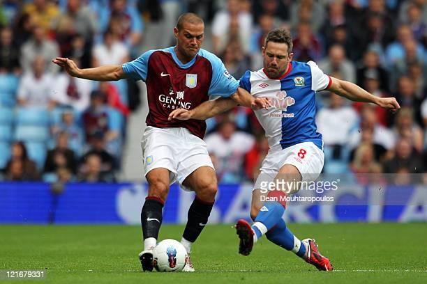 Luke Young of Aston Villa and David Dunn of Blackburn battle for the ball during the Barclays Premier League match between Aston Villa and Blackburn...