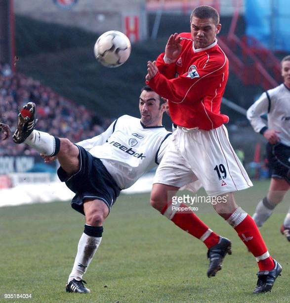 Luke Young of Charlton Athletic and Youri Djorkaeff of Bolton Wanderers in action during the FA Barclaycard Premiership match between Charlton...