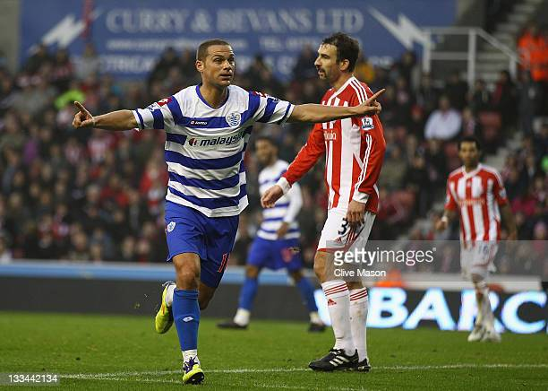 Luke Young of Queens Park Rangers celebrates his goal during the Barclays Premier League match between Stoke City and Queens Park Rangers at...