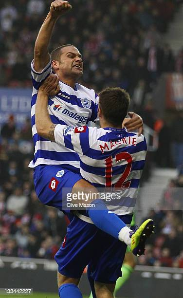 Luke Young of Queens Park Rangers celebrates his goal with team mate Jamie Mackie during the Barclays Premier League match between Stoke City and...
