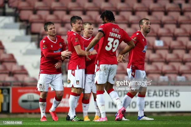 Luke Young of Wrexham celebrates scoring his side's first goal during the Vanarama National League match between Wrexham and Aldershot Town at...
