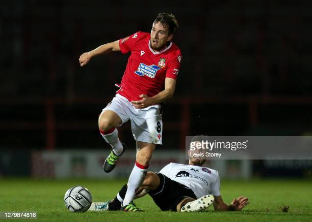 Luke Young of Wrexham is tackled by Ryan Upward of Maidenhead United during the Vanarama National League match between Wrexham and Maidenhead United...