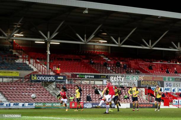 Luke Young of Wrexham scores his team's second goal from the penalty spot during the Vanarama National League match between between Wrexham and...