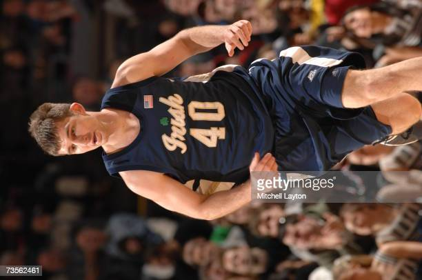 Luke Zeller of the Notre Dame Fighting Irish runs upcourt against the Georgetown Hoyas in the Big East College Basketball Tournament Semifinals at...