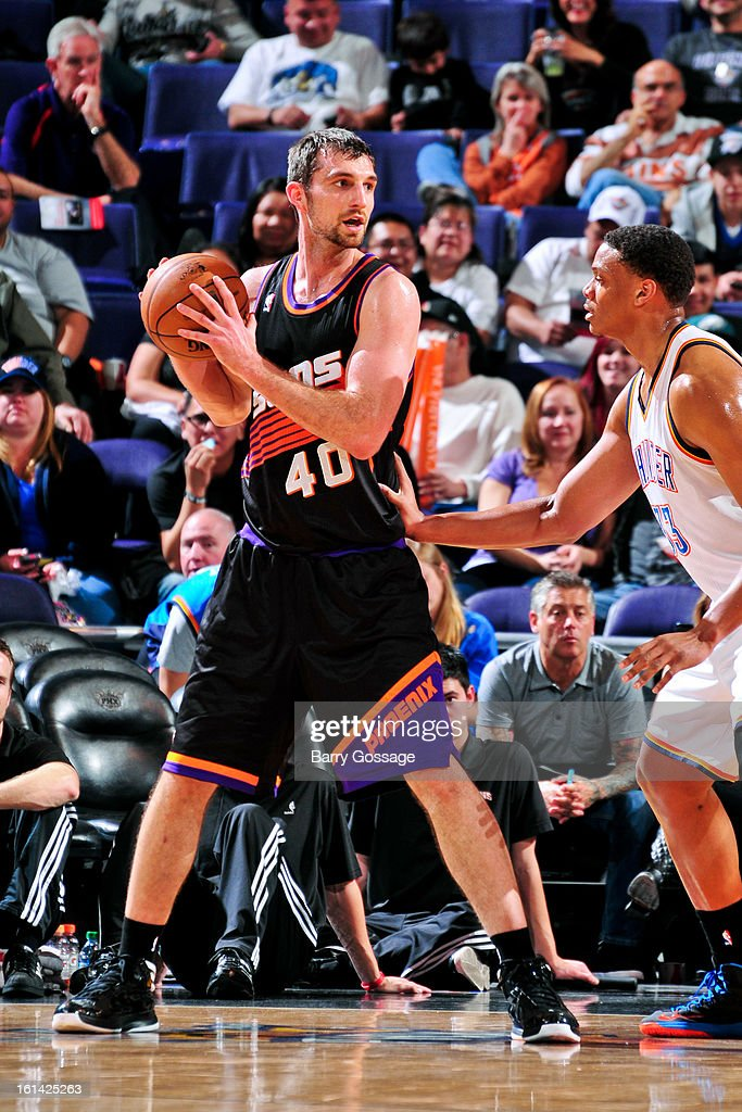 Luke Zeller #40 of the Phoenix Suns controls the ball against Daniel Orton #33 of the Oklahoma City Thunder on February 10, 2013 at U.S. Airways Center in Phoenix, Arizona.