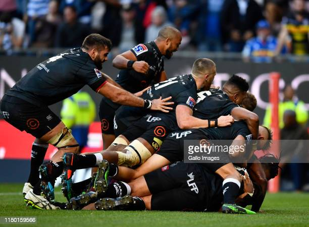 Lukhanyo Am and team mates of The Sharks celebrate winning the match after scoring a try during the Super Rugby match between DHL Stormers and Cell C...