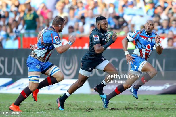 Lukhanyo Am of the Cell C Sharks on the attack with Cornel Hendricks of the Vodacom Bulls and Duane Vermeulen of the Vodacom Bulls in pursuit during...