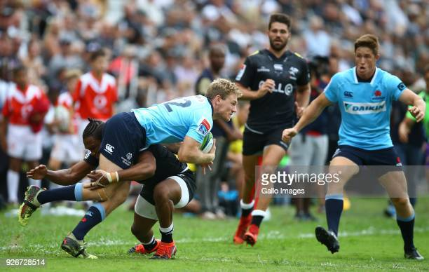 Lukhanyo Am of the Cell C Sharks tackling Bryce Hegarty of the Waratahs during the Super Rugby match between Cell C Sharks and Waratahs at Kings Park...