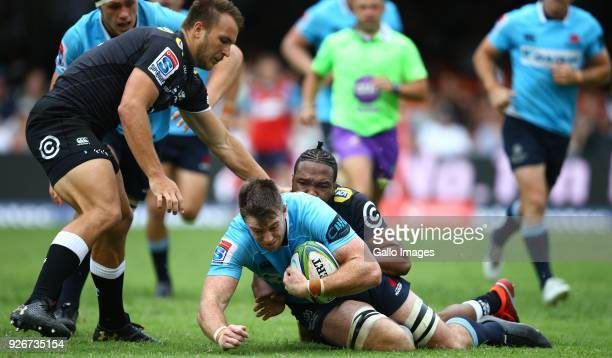 Lukhanyo Am of the Cell C Sharks tackling Jed Holloway of the Waratahs during the Super Rugby match between Cell C Sharks and Waratahs at Kings Park...