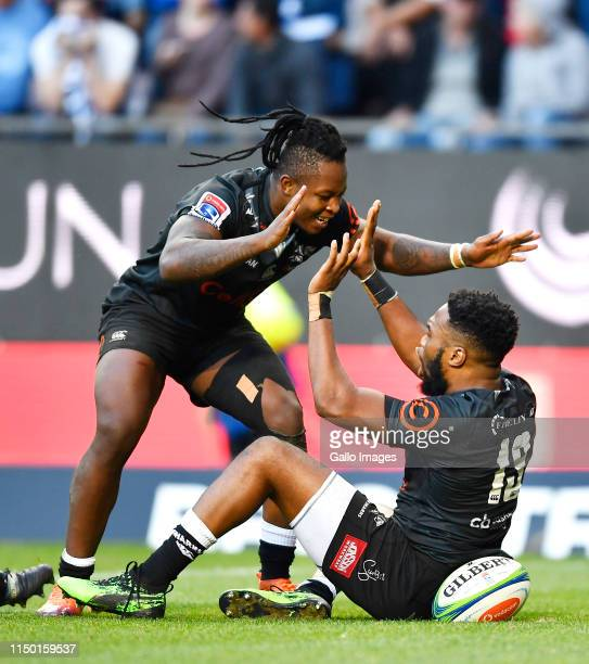 Lukhanyo Am of The Sharks celebrate after scoring a try during the Super Rugby match between DHL Stormers and Cell C Sharks at DHL Newlands on June...