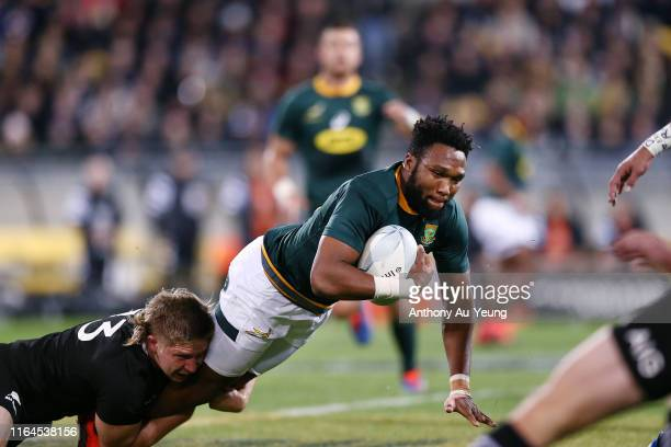 Lukhanyo Am of the Springboks is tackled by Jack Goodhue of the All Blacks during the 2019 Rugby Championship Test Match between New Zealand and...