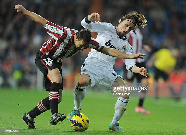 Lukja Modric of Real Madrid battles for the ball against Carlos Gurpegi of Athletic Club during the La Liga match between Real Madrid CF and Athletic...