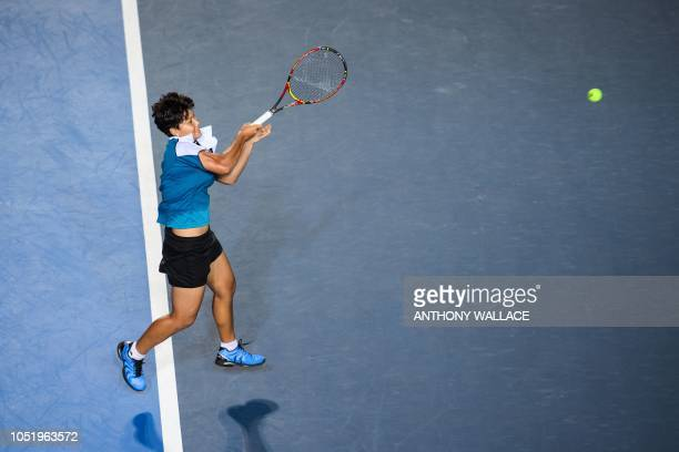Luksika KumKhum of Thailand hits a return during her quarterfinal women's singles match against Garbine Muguruza of Spain at the Hong Kong Open...