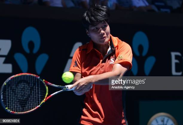 Luksika Kumkhum of Thailand in action against Belinda Bencic of Switzerland during Women's single match on the third day of 2018 Australian Open at...