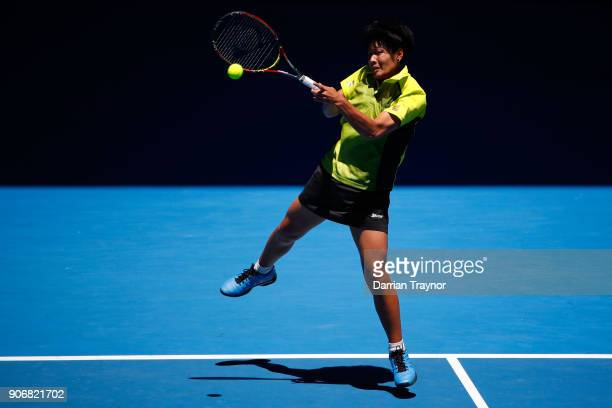 Luksika Kumkhum of Thailand plays a backhand in her third round match against Petra Martic of Croatia on day five of the 2018 Australian Open at...