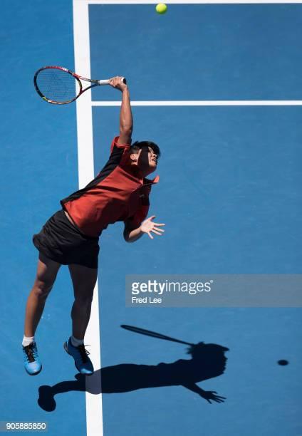 Luksika Kumkhum of Thailand serves in her second round match against Belinda Bencic of Switzerland on day three of the 2018 Australian Open at...