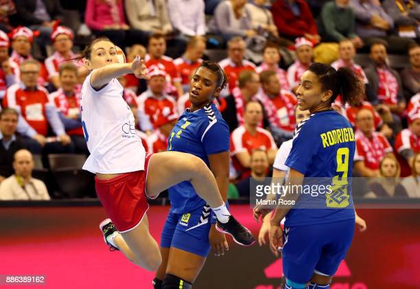 Luliia Managarova of Russia challenges Tamires Araujo of Brazil during the IHF Women's Handball World Championship group C match between Russia and...