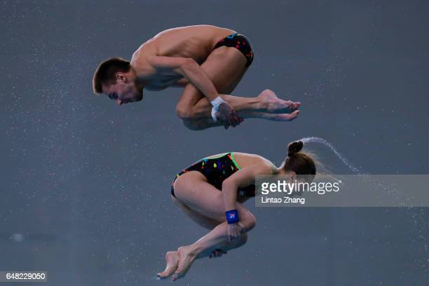 Luliia Timoshinina and Viktor Minibaev of Russia compete in the Mixed 10m Synchro Platform final on day three of the FINA/NVC Diving World Series...