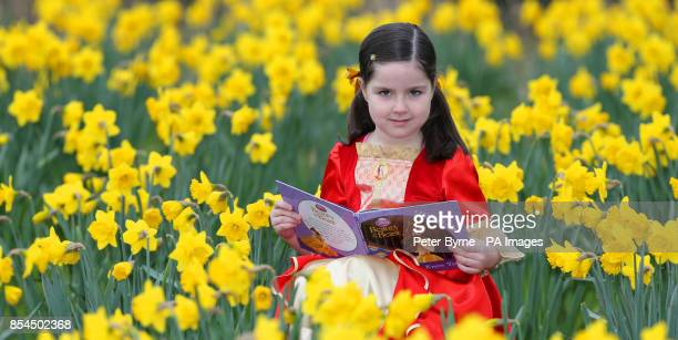 Lulu Byrne 6 from Liverpool reads from one of her favourite books in Belle Vale Park in Liverpool on World Book Day