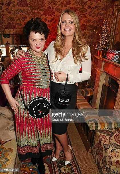Lulu Guinness and Lady Kitty Spencer attend as Lulu Guinness Jasmine Guinness celebrate Christmas with friends at Upstairs 5 Hertford Street on...
