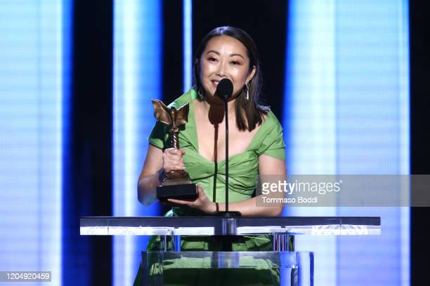 Lulu Wang accepts the Best Supporting Female award for 'The Farewell' on behalf of winner Zhao Shuzhen onstage during the 2020 Film Independent...
