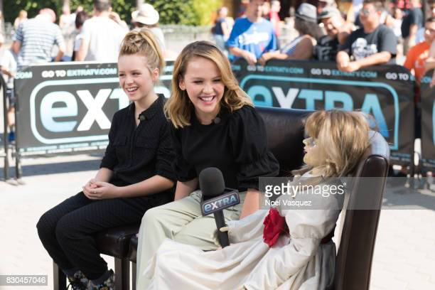 Lulu Wilson Talitha Bateman and 'the doll from the film Annabelle ' visit Extra at Universal Studios Hollywood on August 11 2017 in Universal City...