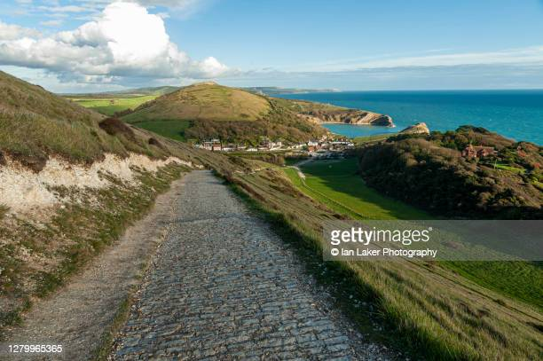 lulworth cove, dorset, uk. 9 october 2020. aerial view from the south west coastal path of lulworth cove and the village of west lulworth. - footpath stock pictures, royalty-free photos & images