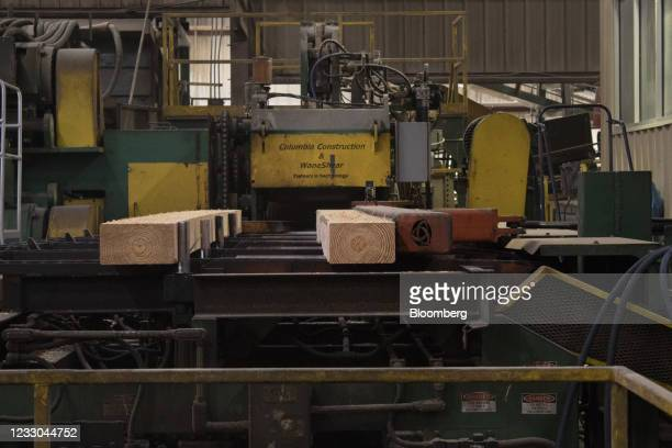 Lumber moves across a conveyor belt at the Charles Ingram Lumber Company sawmill in Effingham, South Carolina, U.S., on Monday, May 10, 2021.Over...