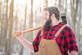 handsome young man dressed as lumberjack