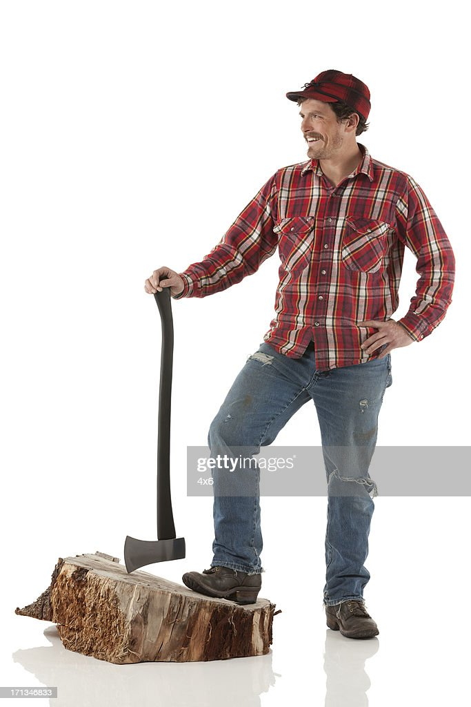 Lumberjack standing with an axe : Stock Photo