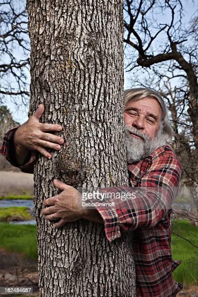 lumberjack tree hugger - tree hugging stock pictures, royalty-free photos & images