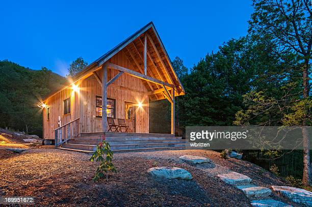 luminous cabin at daybreak - log cabin stock pictures, royalty-free photos & images