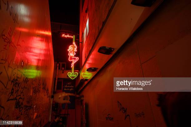 A luminous sign advertises a lap dancing bar in the Red Light District on April 12 2019 in Amsterdam The Netherlands Amsterdam is famous for its...