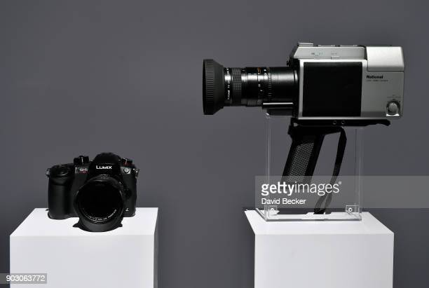 Lumix GH5S mirrorless camera is displayed with a 1982 home video camera at the Panasonic booth during CES 2018 at the Las Vegas Convention Center on...