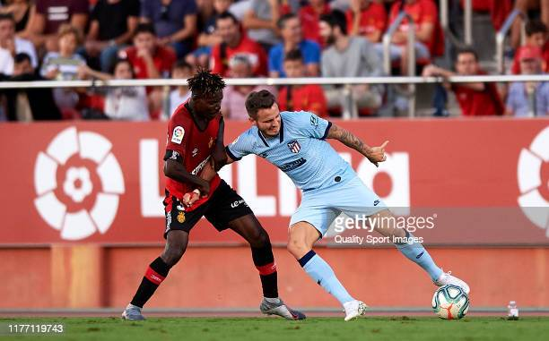 Lumor Agbenyenu of RCD Mallorca competes for the ball with Saul Ñiguez of Atletico de Madrid during the Liga match between RCD Mallorca and Club...