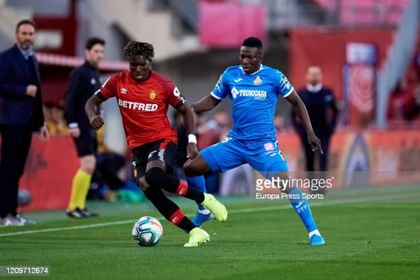 Lumor Agbenyenu of RCD Mallorca protecting the ball agains Oghenekaro Peter Etebo of Getafe CF during the Spanish League La Liga football match...